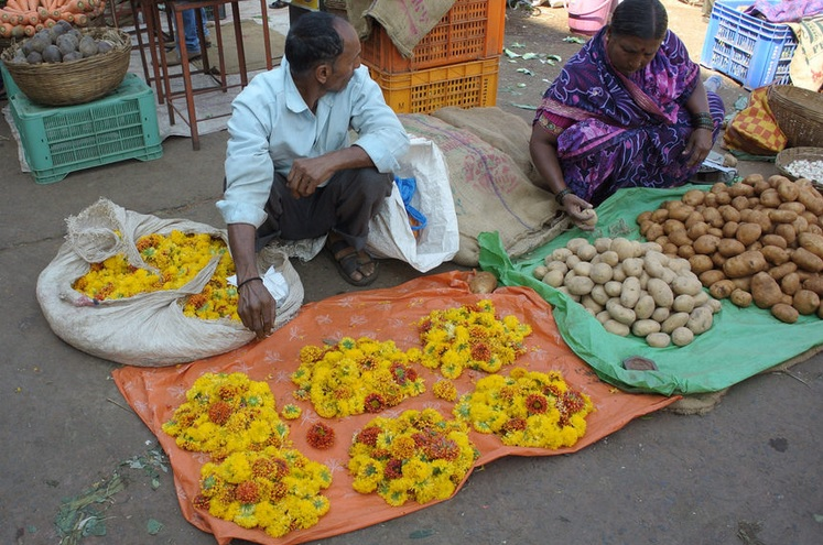 Flowers and potatoes at a market in India