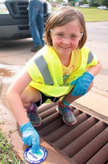 Girl working on stormwater project in Oklahoma